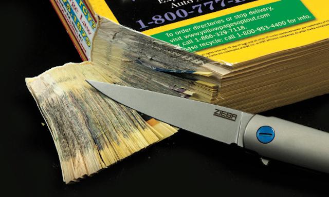 Knife slicing through phonebook