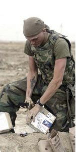 soldier opening mail with knife