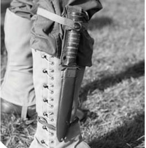 soldier with knife strapped to shin