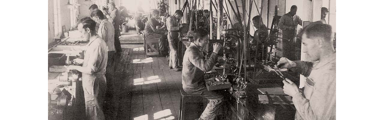 Workers hard at work in Victorinox's newly automated workshop in 1931 crafting multitools