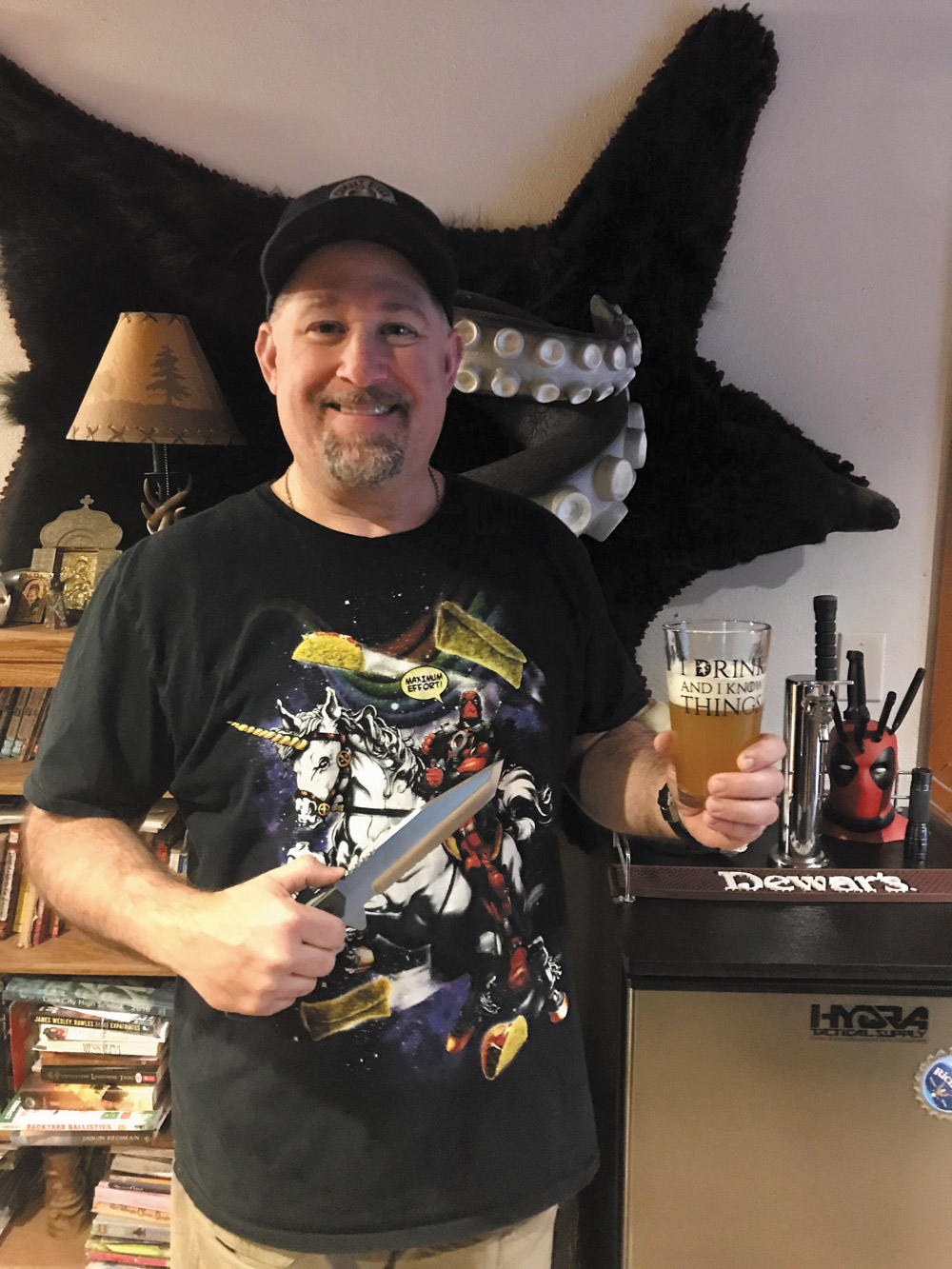 Rich Neyman holding a custom Buck Strider from his collection.