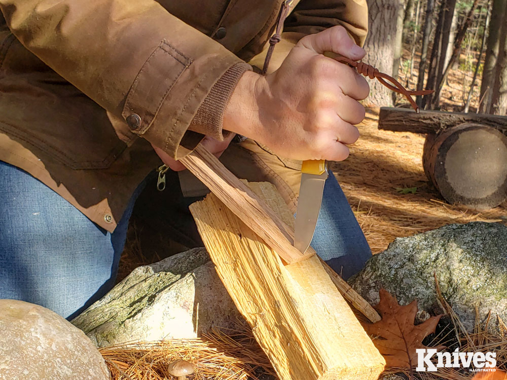The author tested the tip strength of the Layman by driving it tip first into wood to split kindling.