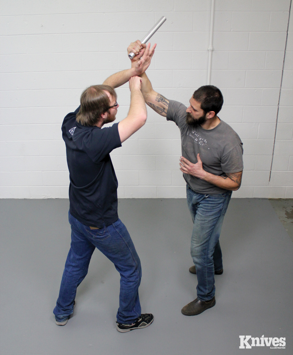 In this traditional technique, the defender blocks the attack with a Roof Block while cutting T the assailant's wrist.