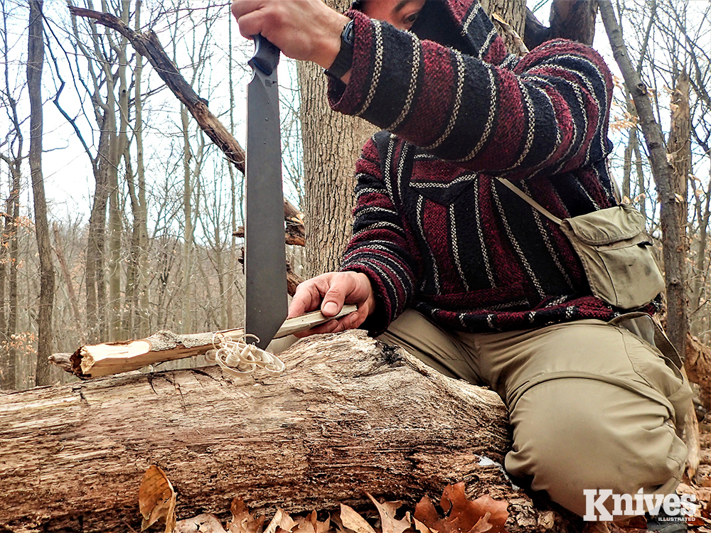 The author makes his tinder and kindling shavings for a fire by pounding the tip of the knife securely in a log and drawing split wood back against the blade.