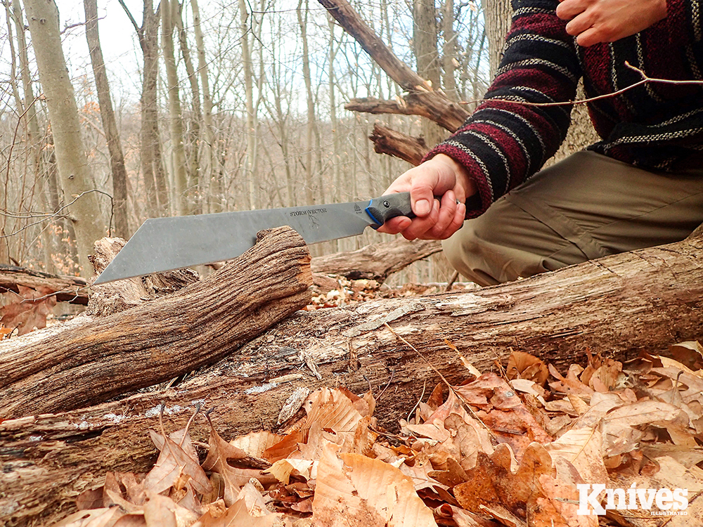 Here, the author uses a Y-crotch of a downed tree to chop into a large piece of oak to split it. The Y-portion of the tree both supports the work and acts as a safe haven for the follow through.