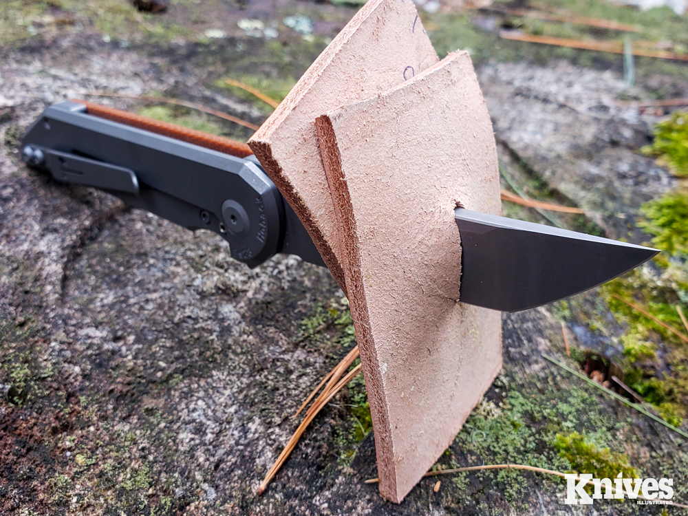 Using a piece of hard foam as a backer, the author tested the puncturing capability of the Radford folder with double stacks of heavy leather.