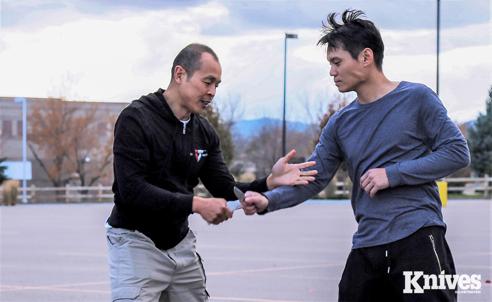Conrad Bui (left) brings elements of several martial arts disciplines together to present basic fundamentals in the Tiga Tactics Edged Weapon Certification Course.