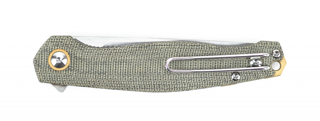 The knife features a wire pocket clip and micarta scales.