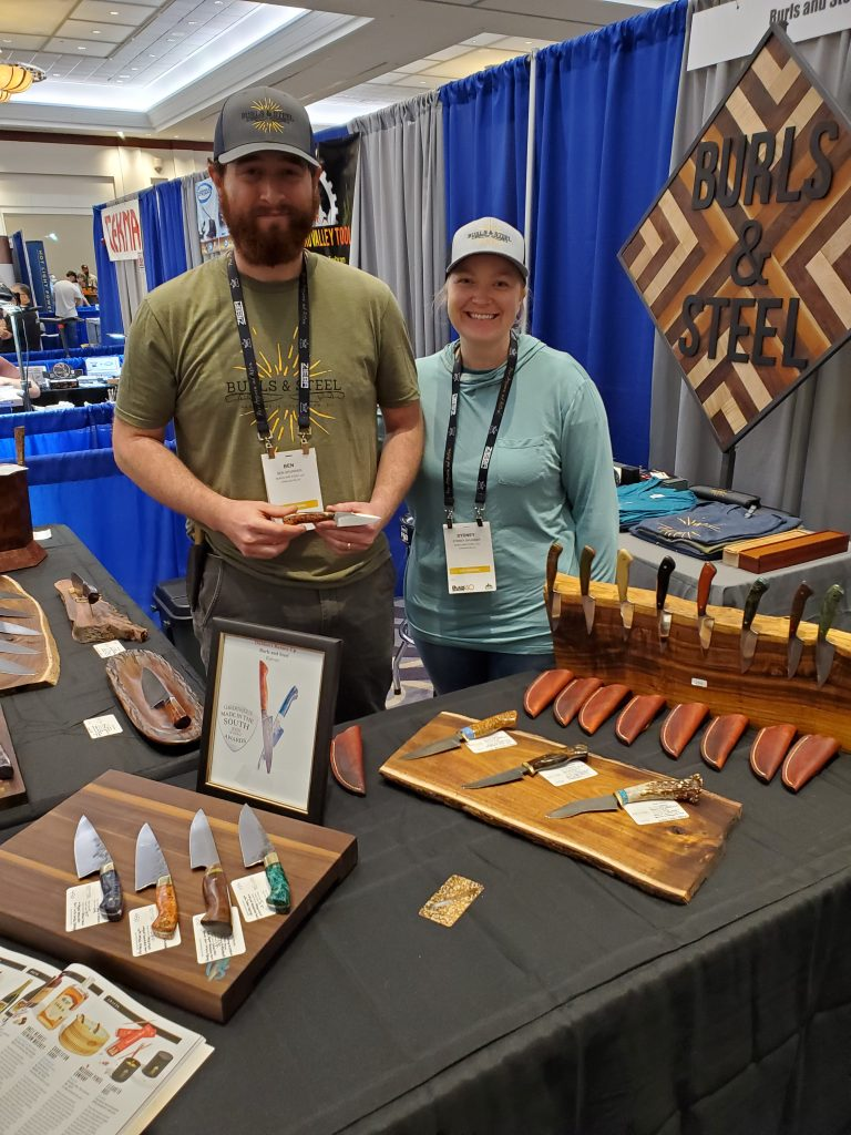 Ben and Sydney Spurrier of Burls and Steel with their 2021 Blade Show display.
