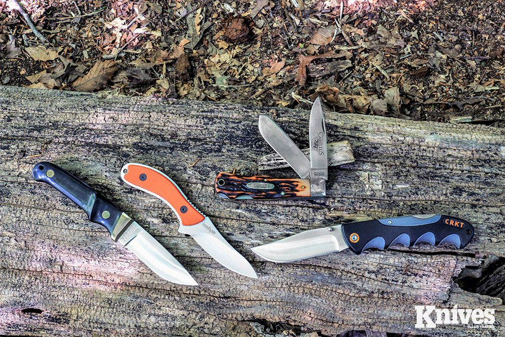Shown (from the left) are: Schrade PH 1, Kershaw 1082OR Field Knife, Camillus two-blade lockback, and CRKT Kommer Free Range Hunter Folder.