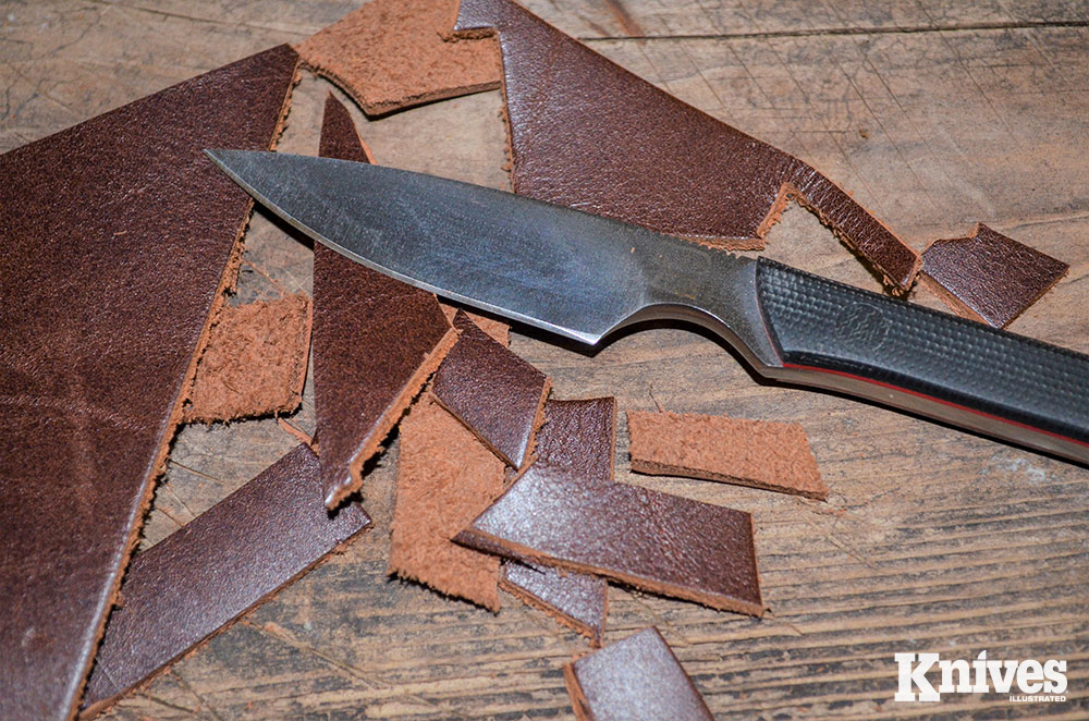 Leather scraps posed little challenge for the knife, though push cuts were more difficult than slices.