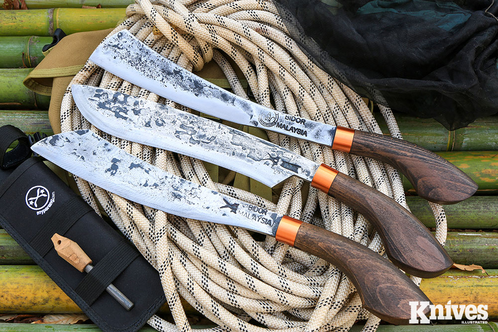"""My Parang Lading, Golok 135, Duku Chandong (top to bottom) knives. The perfect manual """"power tools"""" for adventures abroad or in the backyard."""