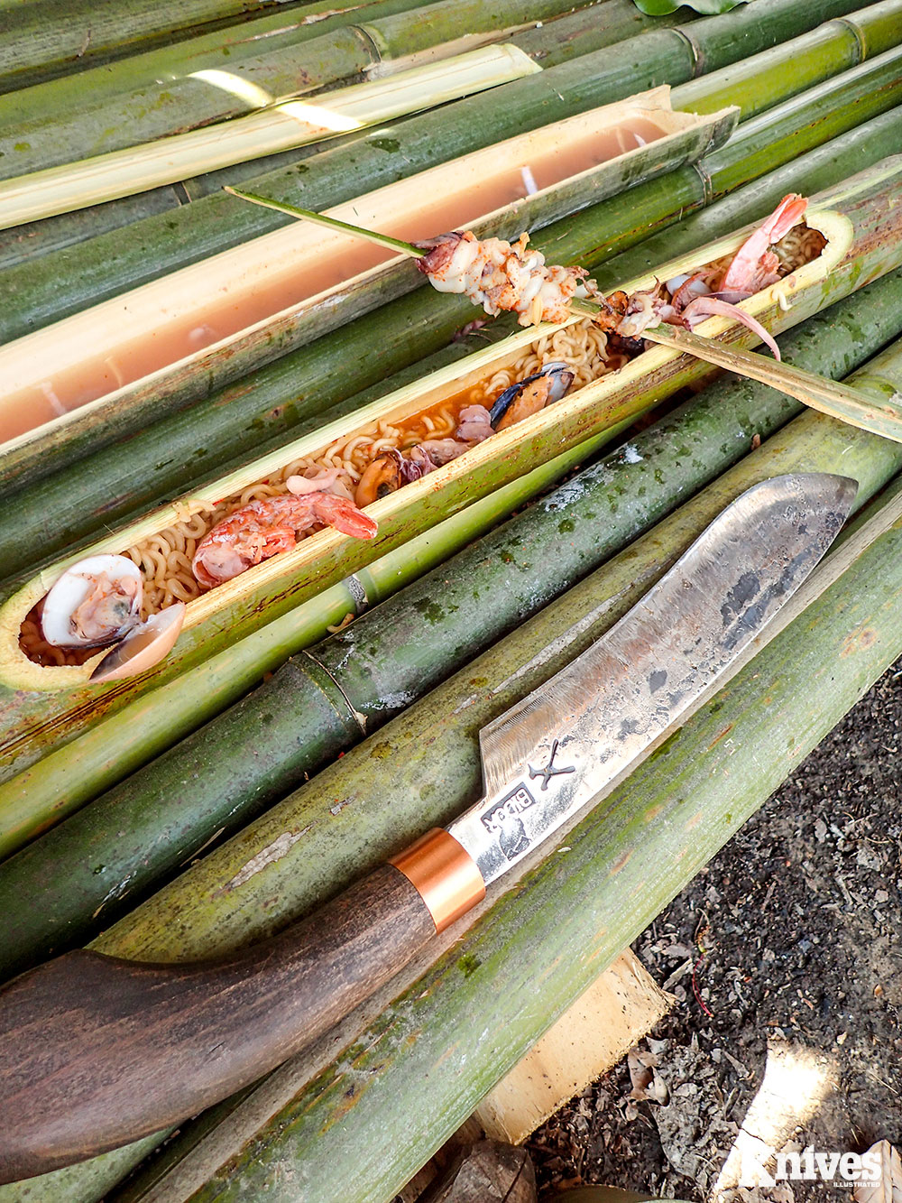 This piece of bamboo was chopped at each side to pry off the top for a cooking tube or serving platter. The bamboo spoon/utensil was used as a skewer.
