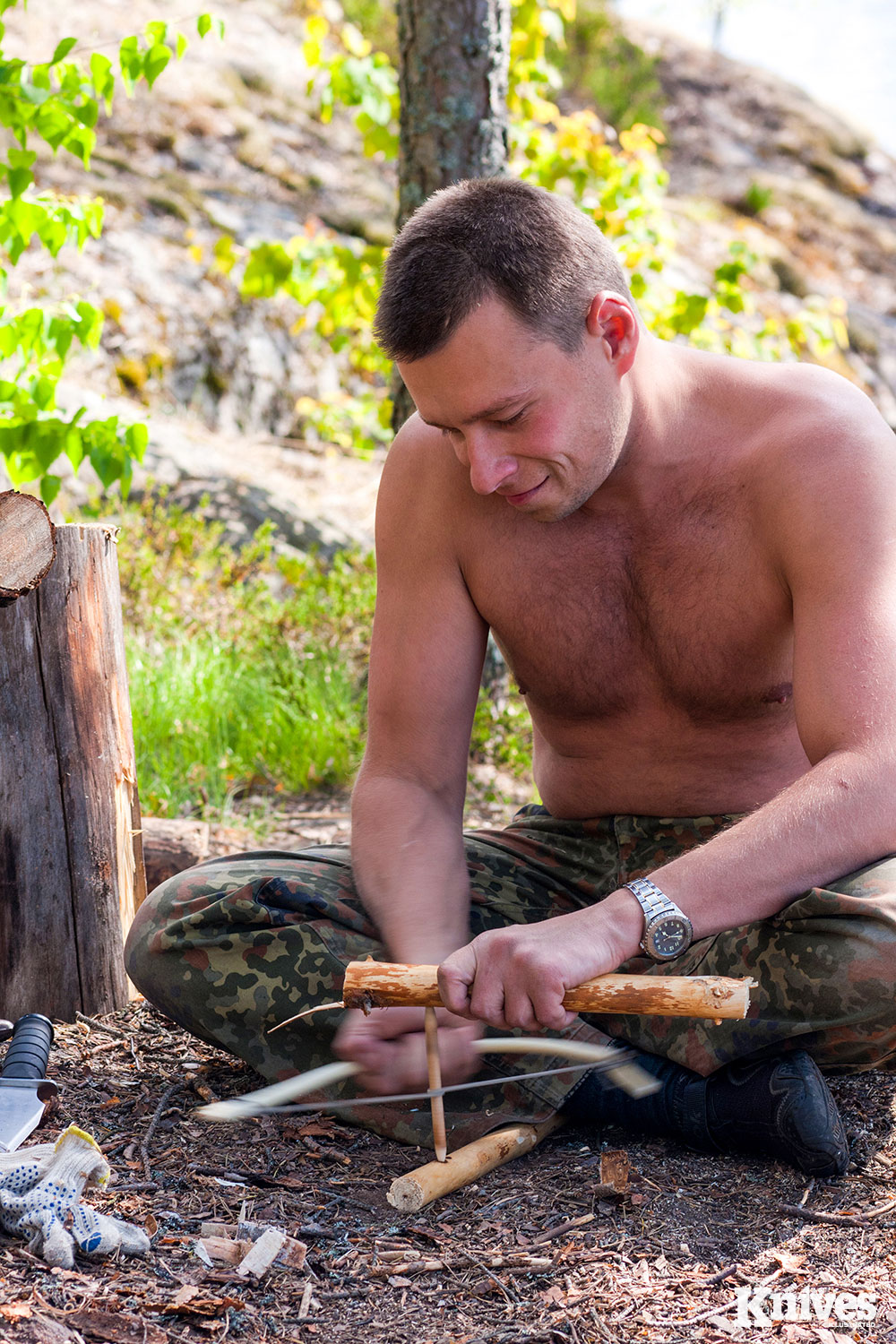 Survival knife will indirectly aid in you having a fire during a cold night, by whittling down the pieces of wood to create a bow drill. Argument/Depositphotos.com photo.